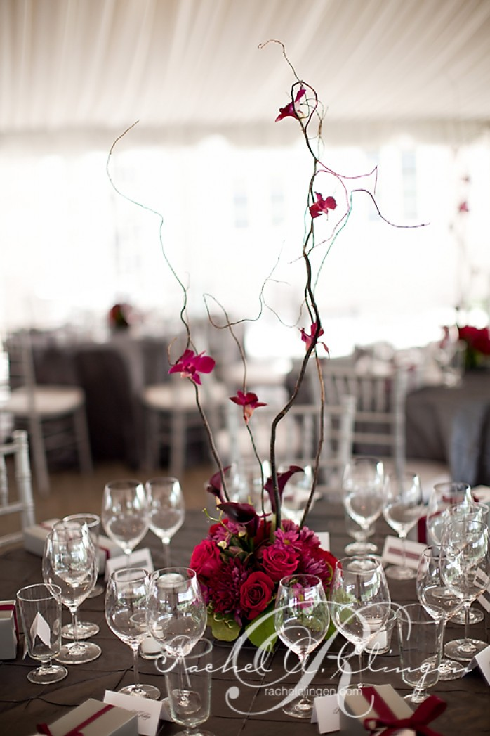 floral table centres with branches and orchids