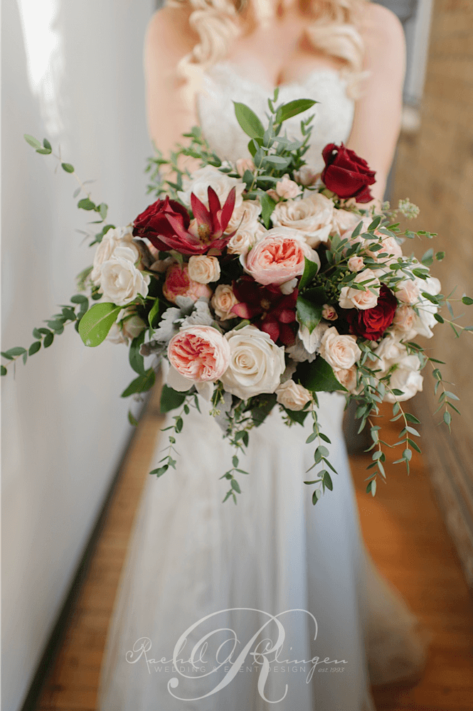 Cascading wedding bouquet roses Toronto wedding florist