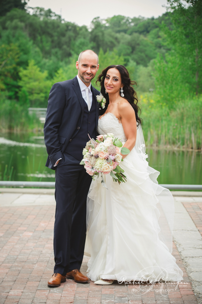 Erik and Seychelles rustic wedding at the Evergreen Brickworks in Toronto was detailed with beautiful cream and pink flowers , accented with silver mercury candlelight.