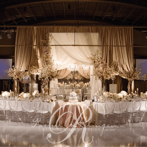 Elaborate draping and decor for wedding head table by Rachel A. Clingen Toronto