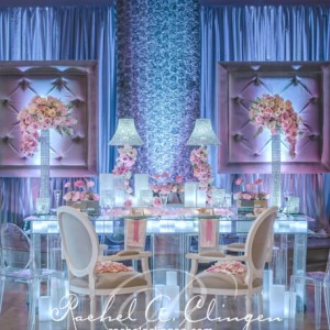 Glowing head table and lush wedding flowers Toronto