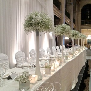 Baby's breath and elegant vases on a head table for a Toronto Wedding