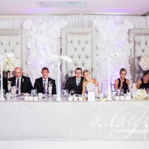 Padded chairs and decorative head table in white for a Toronto Wedding