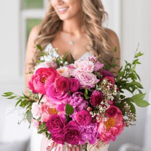 Assorted rich pinks in a stunning wedding bouquet for a Muskoka wedding