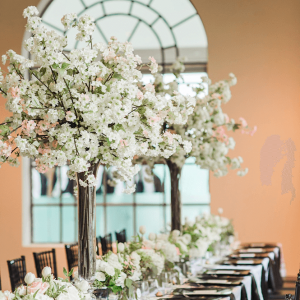 Cherry blossom wedding centerpieces for a Toronto wedding at the Maclaren Art Gallery