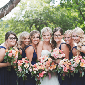 Coral & peach bridal bouquets, lush wedding flowers in Toronto