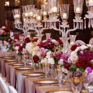 Crystalware centrepieces with rich floral accents Toronto wedding design