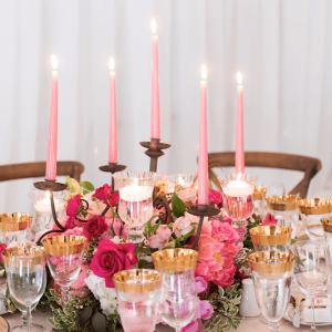 Decorative floral wedding centrepieces with pink candles and accented glassware Toronto