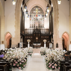 Lush, luxurious aisle decor Toronto church wedding ceremony