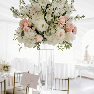 Pink and cream wedding centerpieces for luxurious Toronto tent weddings.