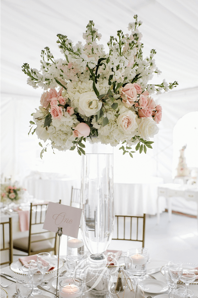 Pink and cream wedding centerpieces for luxurious Toronto tent ...