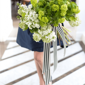 Stylish, nouveau wedding bouquet with lush greenery and white accents Toronto