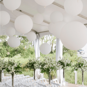 Outdoor tent wedding with giant balloons Muskoka