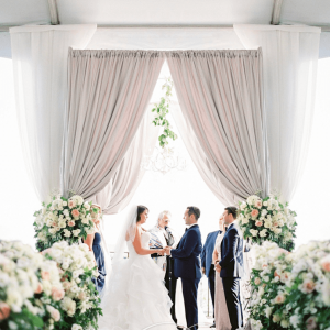 Wed luxe featured elegant draped chuppah wedding ceremony.
