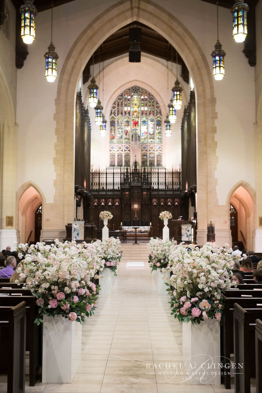 The metropolitan united church in down town toronto hosted Courtney and Anthony's guests for their spring wedding decorated by wedding designer Rachel A. Clingen Wedding Design. Cherry blossoms lined with aisle in contemporary tins.