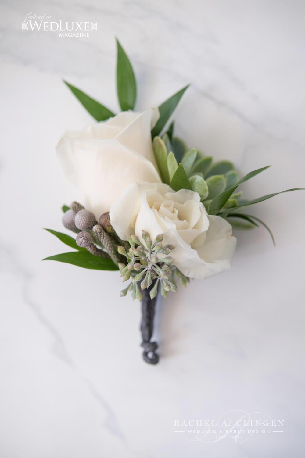 white-boutiniere-groom-flower