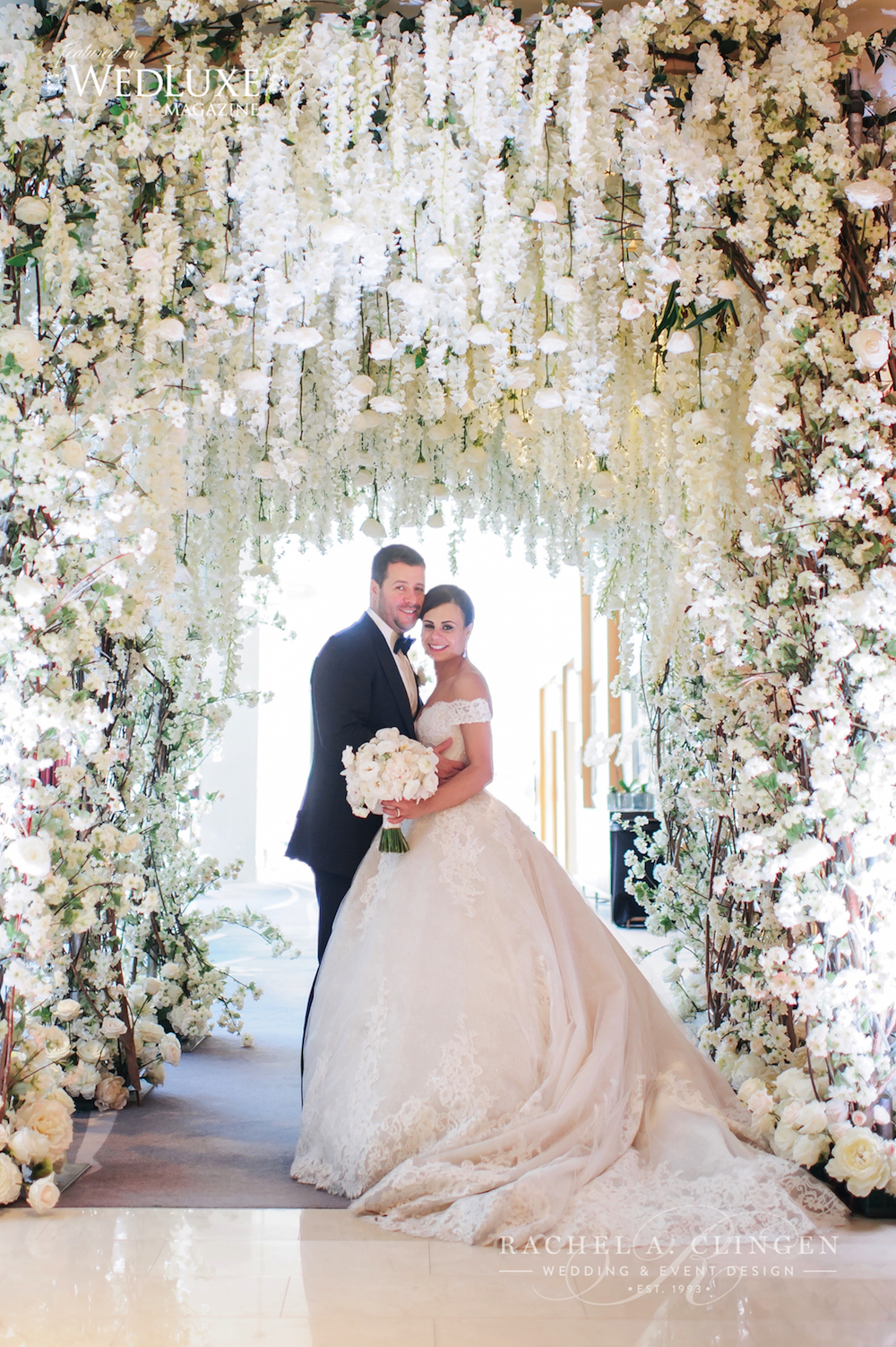 This gorgeous rose and wisteria canopy was designed by Rachel A. Clingen of Toronto. The wedding took place at the Ritz Carlton.