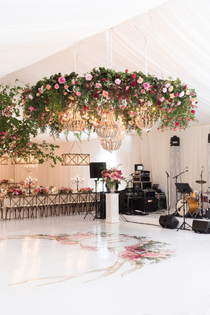 suspended flowers dance floor tent wedding