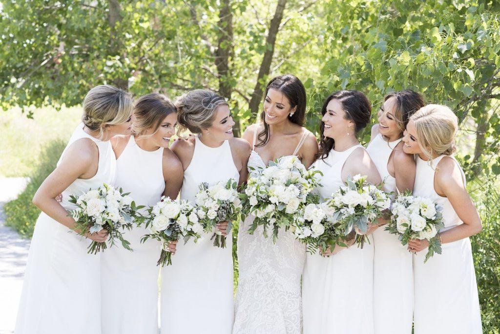 white bridesmaids flowers