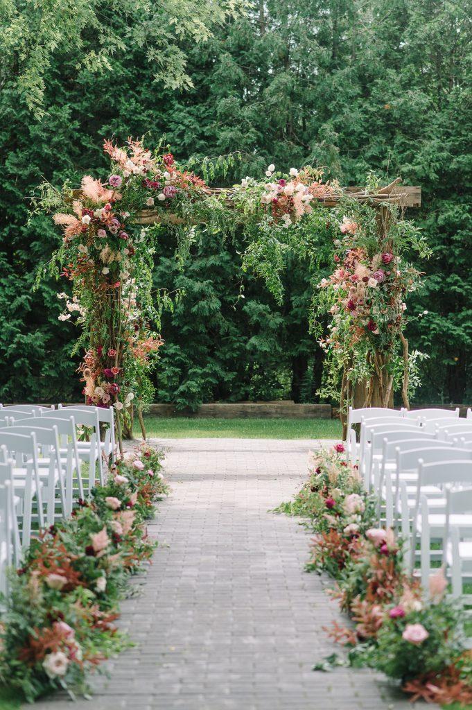 dusty rose wedding flowers arch