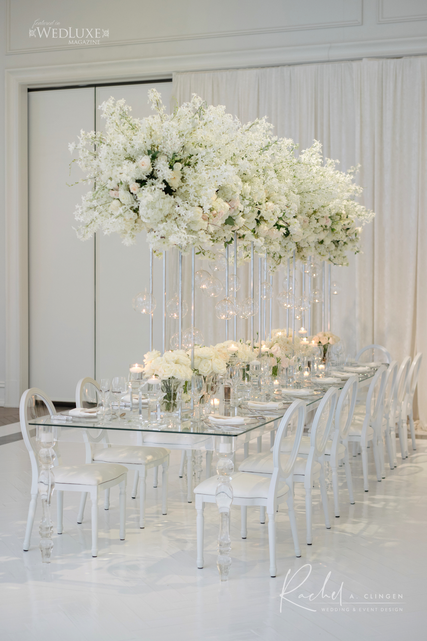luxury all white tall centrepieces rachel a clingen